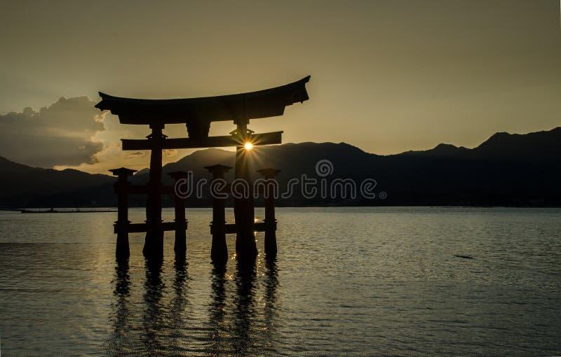 Torii -  floating gate of Miyajima (Itsukushima ) island at sunset time. Japan royalty free stock photo
