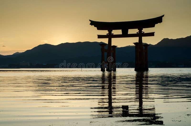 Torii -  floating gate of Miyajima (Itsukushima ) island at sunset time. Japan stock images