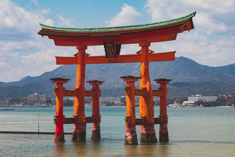 Torii gate at Miyajima Island, Japan during low tide. Torii gate at Miyajima Island, Japan during receding low tide stock image