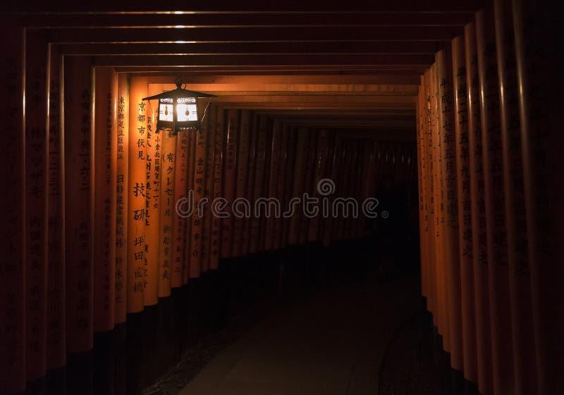 Torii gates at Fushimi Inari Shrine at night in Kyoto, Japan stock image