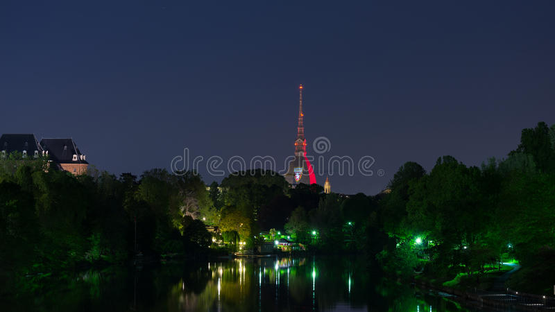 Torino (Turin, Italy), garnet colored Mole Antonelliana. Turin, Italy - May 4, 2016: Torino (Turin, Italy), panorama cityscape reflected on Po River. Mole stock photos