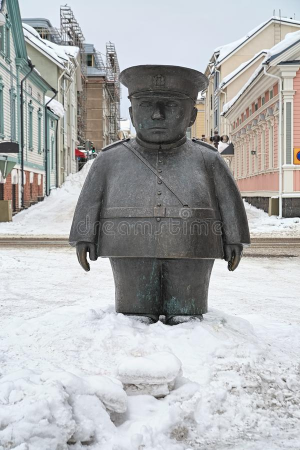 Toripolliisi sculpture in Oulu, Finland. Oulu, Finland. Toripolliisi - The Bobby at the Market Place - sculpture in winter. It was made by sculptor Kaarlo royalty free stock image