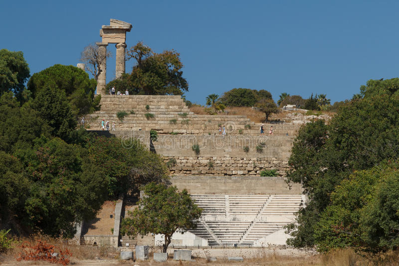 Torists visiting ruins of the ancient acropolis royalty free stock photo