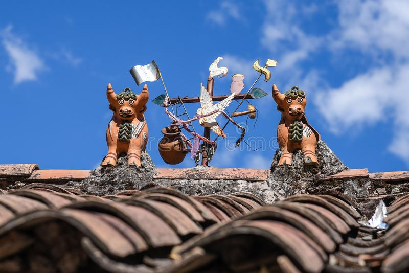 Toritos de Pucara - Peruvian symbol on the house rooftop. Toritos de Pucara - Two bulls placed on the top of the house roof for luck and prosperity. Peruvian royalty free stock photos