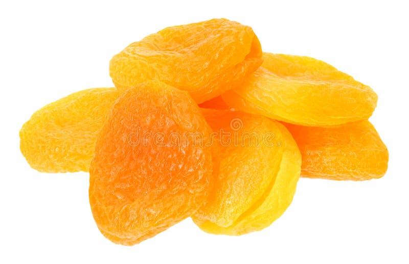 Torkad aprikos som isoleras p? en vit bakgrund arkivfoton