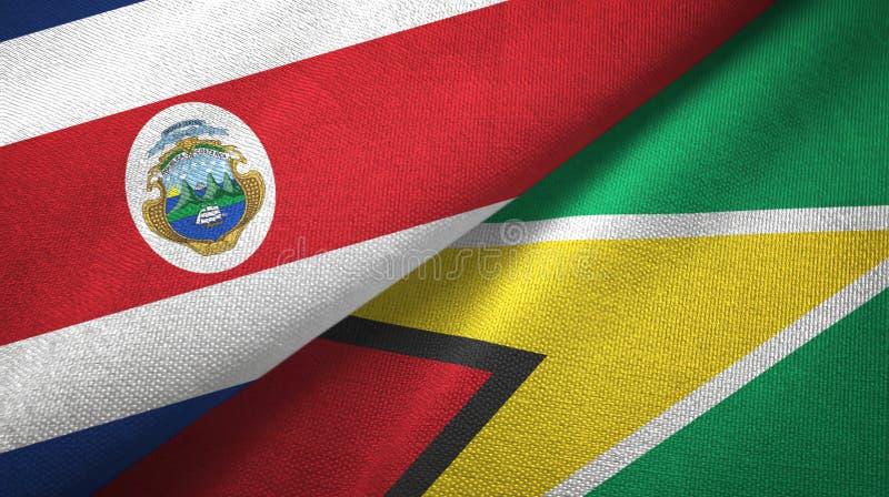 Torkduk f?r Costa Rica och Guyana tv? flaggatextil, tygtextur royaltyfri illustrationer