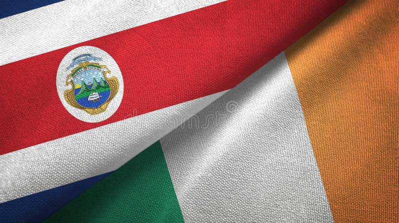 Torkduk f?r Costa Rica och Irland tv? flaggatextil, tygtextur royaltyfri illustrationer