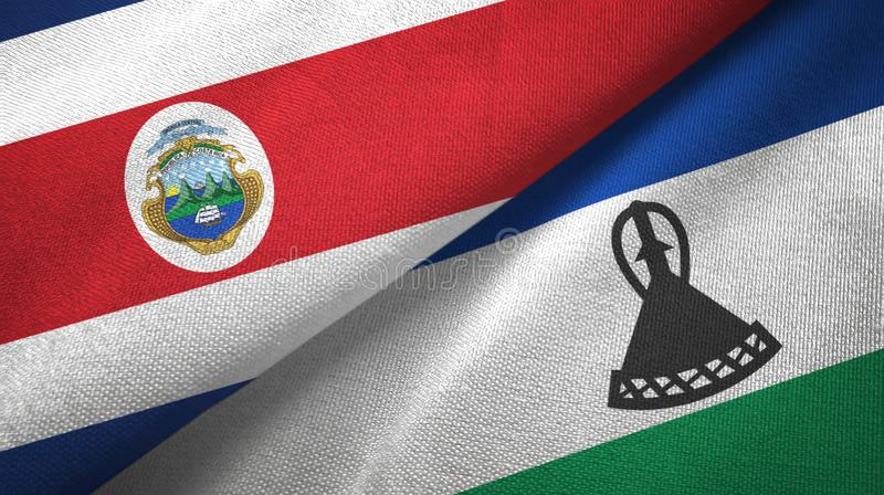 Torkduk f?r Costa Rica och Lesotho tv? flaggatextil, tygtextur royaltyfri illustrationer