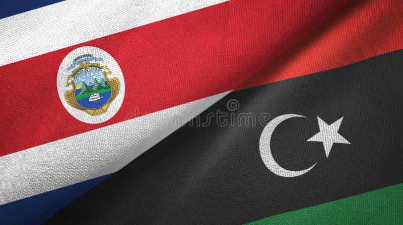 Torkduk f?r Costa Rica och Libyen tv? flaggatextil, tygtextur royaltyfri illustrationer