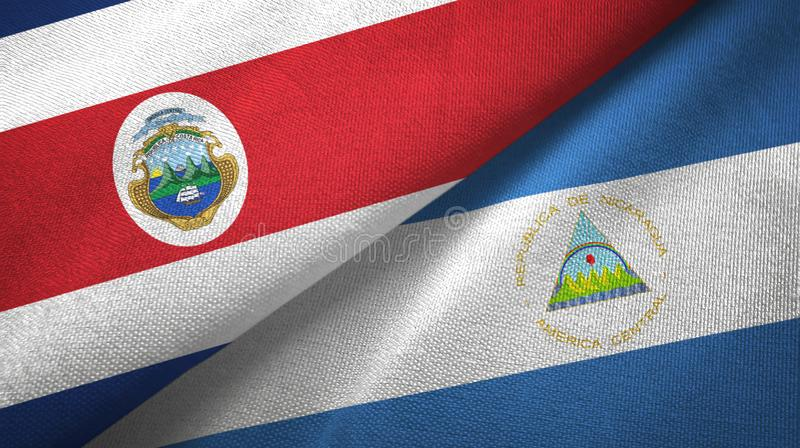Torkduk f?r Costa Rica och Nicaragua tv? flaggatextil, tygtextur stock illustrationer