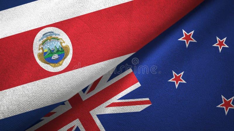 Torkduk f?r Costa Rica och Nya Zeeland tv? flaggatextil, tygtextur royaltyfri illustrationer