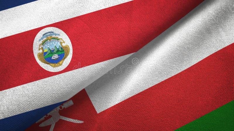 Torkduk f?r Costa Rica och Oman tv? flaggatextil, tygtextur royaltyfri illustrationer