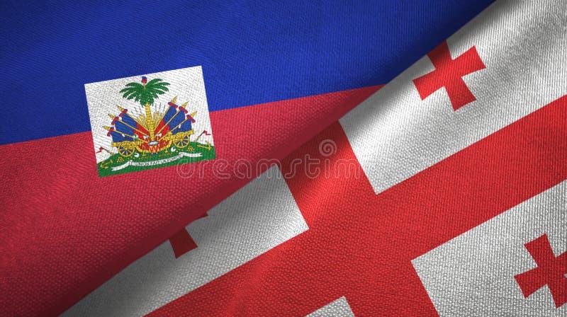 Torkduk f?r Haiti och Georgia tv? flaggatextil, tygtextur arkivbild