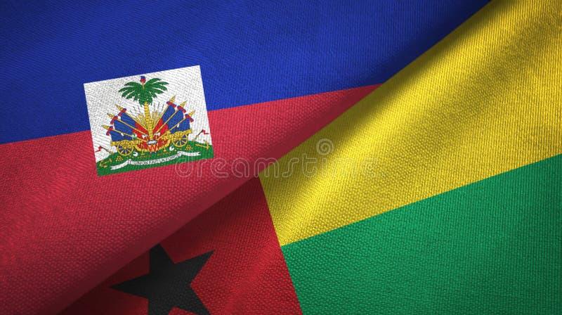 Torkduk f?r Haiti och Guinea-Bissau tv? flaggatextil, tygtextur arkivfoto