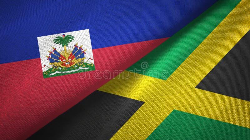 Torkduk f?r Haiti och Jamaica tv? flaggatextil, tygtextur arkivbilder