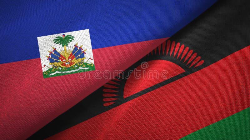 Torkduk f?r Haiti och Malawi tv? flaggatextil, tygtextur arkivfoton