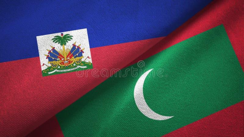 Torkduk f?r Haiti och Maldiverna tv? flaggatextil, tygtextur arkivbilder