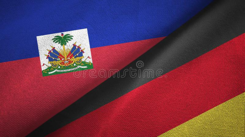 Torkduk f?r Haiti och f?r Tyskland tv? flaggatextil, tygtextur arkivbilder