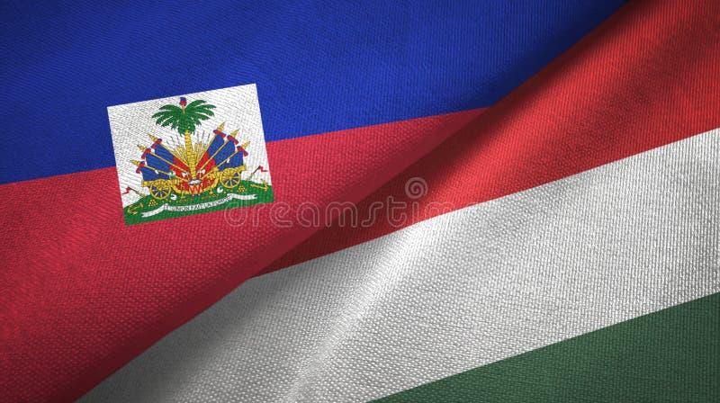 Torkduk f?r Haiti och f?r Ungern tv? flaggatextil, tygtextur fotografering för bildbyråer