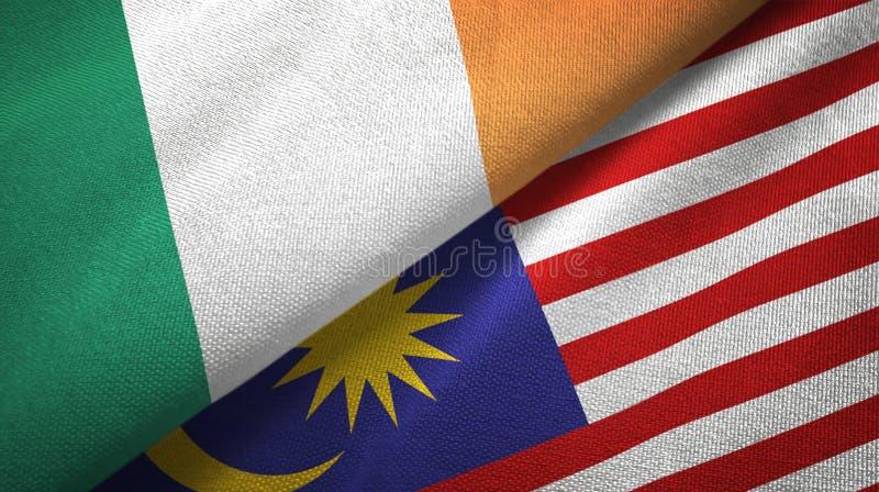 Torkduk för Irland och Malaysia två flaggatextil, tygtextur royaltyfri illustrationer