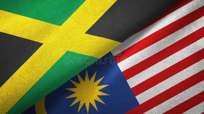 Torkduk för Jamaica och Malaysia två flaggatextil, tygtextur royaltyfri illustrationer
