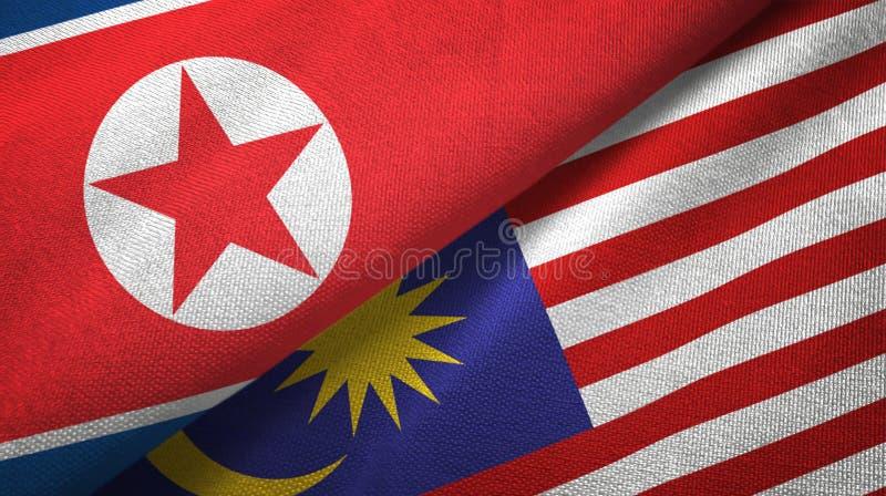 Torkduk för Nordkorea och Malaysia två flaggatextil, tygtextur royaltyfri illustrationer