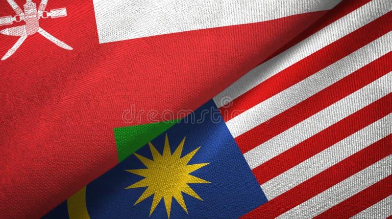 Torkduk för Oman och Malaysia två flaggatextil, tygtextur royaltyfri illustrationer