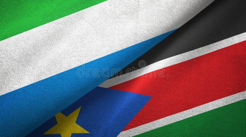 Torkduk f?r Sierra Leone och s?derSudan tv? flaggatextil, tygtextur arkivbild