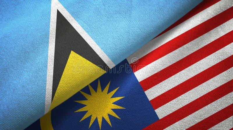 Torkduk för St Lucia och Malaysia två flaggatextil, tygtextur stock illustrationer