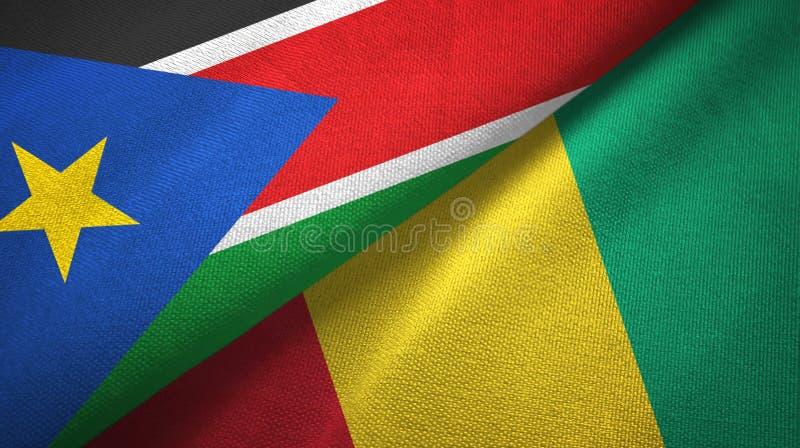 Torkduk för textil för södra Sudan och Guinea två flaggor, tygtextur royaltyfria bilder