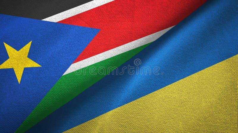Torkduk för textil för södra Sudan och Ukraina två flaggor, tygtextur royaltyfria foton