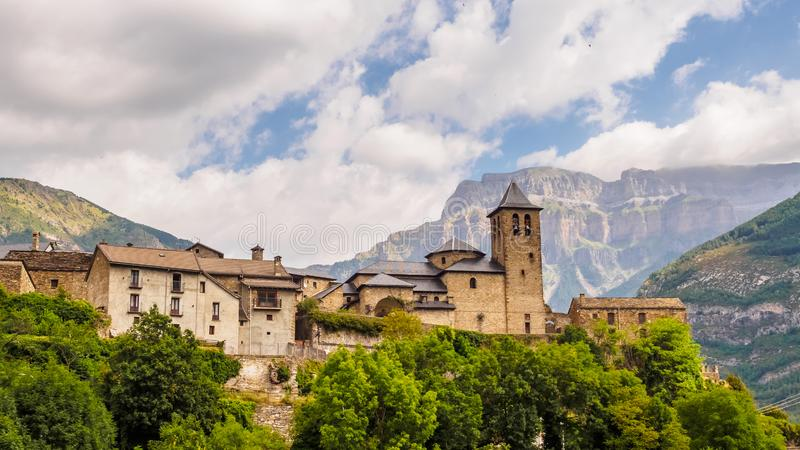 Torla Ordesa, church with the mountains at bottom, Pyrenees Spain royalty free stock images