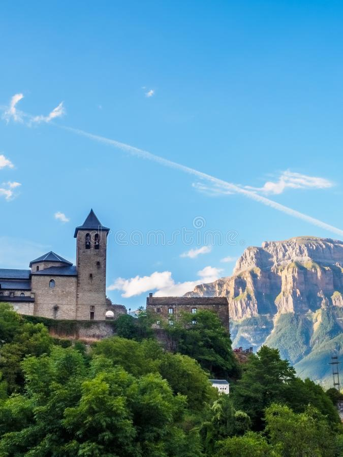 Torla Ordesa, church with the mountains at bottom, Pyrenees Spain vertical royalty free stock photo