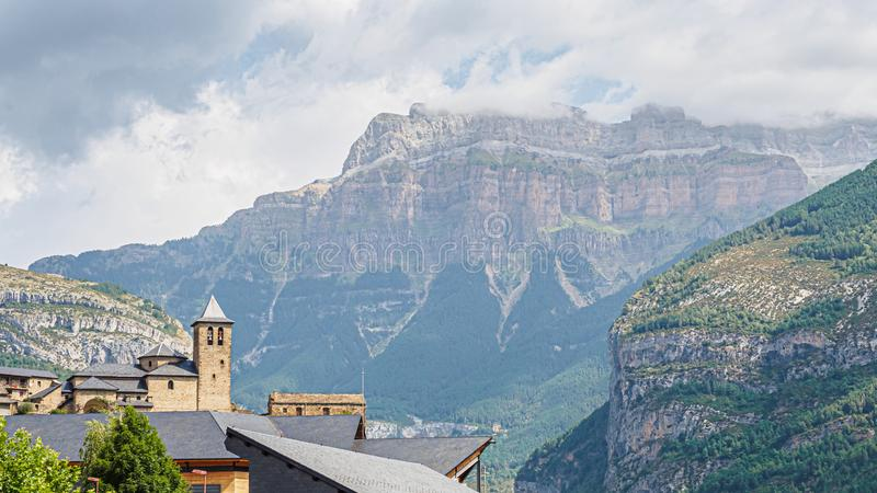 Torla Ordesa, church with the mountains at bottom, Pyrinees stock photography