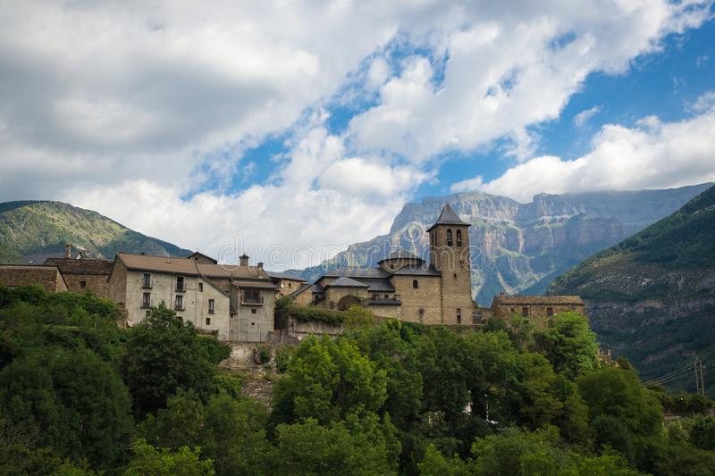 Torla Ordesa, church with the mountains at bottom, Pyrinees Spain royalty free stock photography