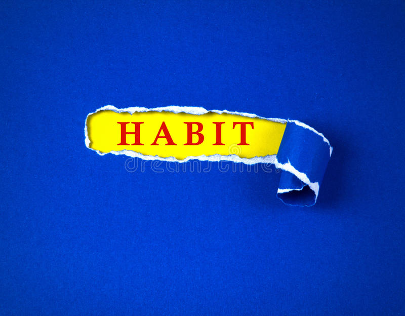 Torn blue Paper and space for text with yellow paper background. Torn blue Paper and space for habit text with a yellow paper background , change habit concept royalty free stock photo