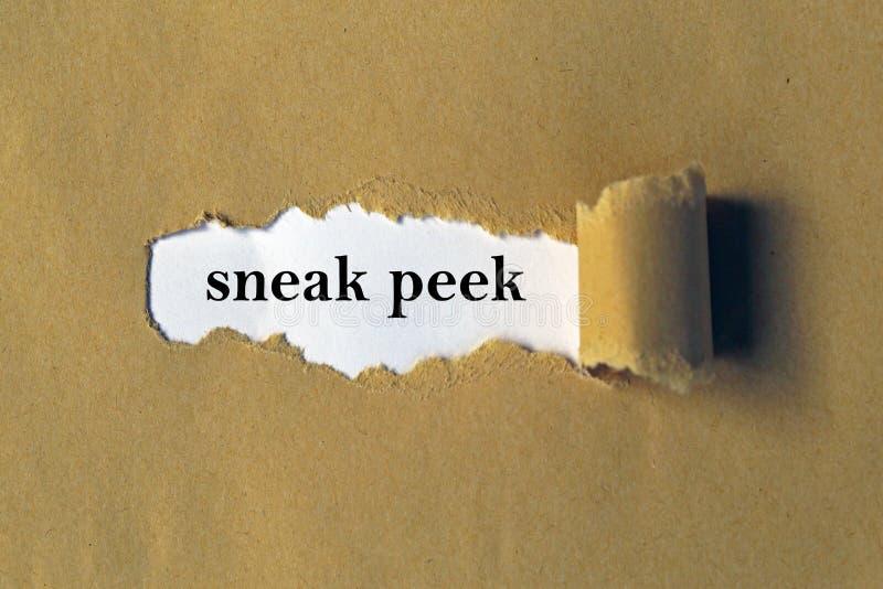 Sneak peek. A torn brown paper background revealing the words sneak peek stock photos