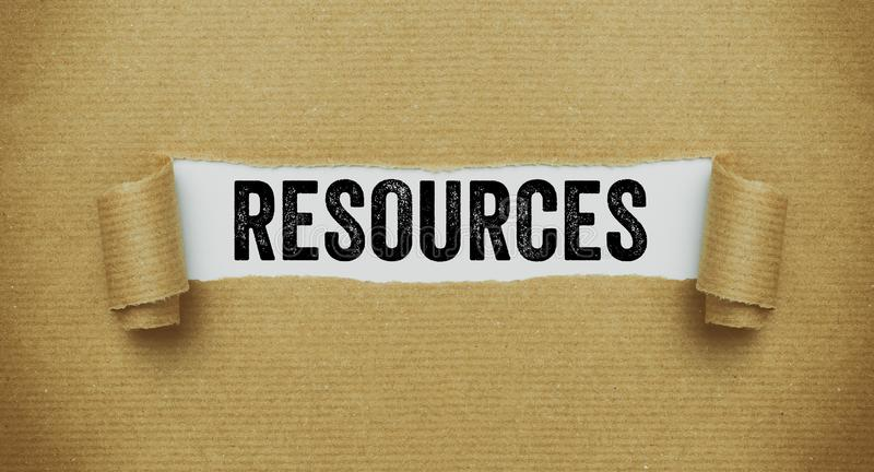 Torn brown paper revealing the word Resources royalty free stock images