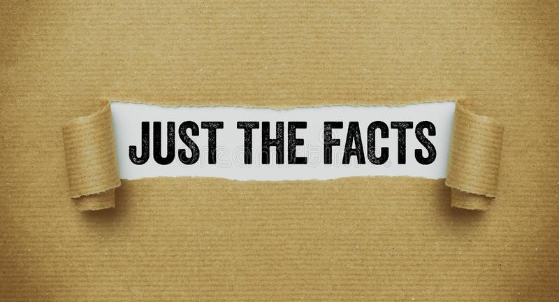 Torn brown paper revealing the words Just the facts royalty free stock photography