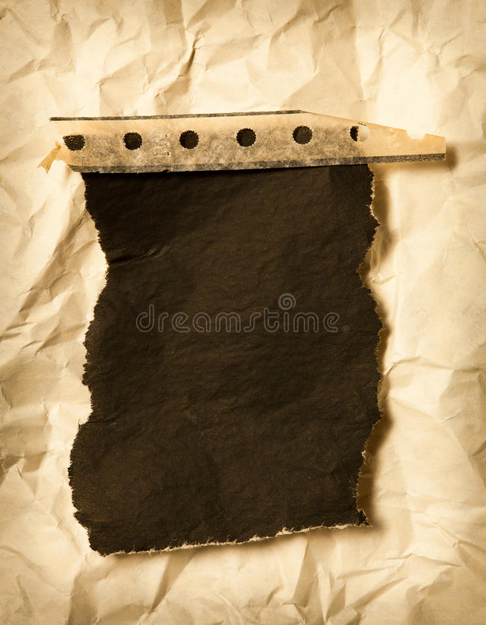 Torn carbon paper on wrinkled background. Torn carbon paper on wrinkled paper background royalty free stock images