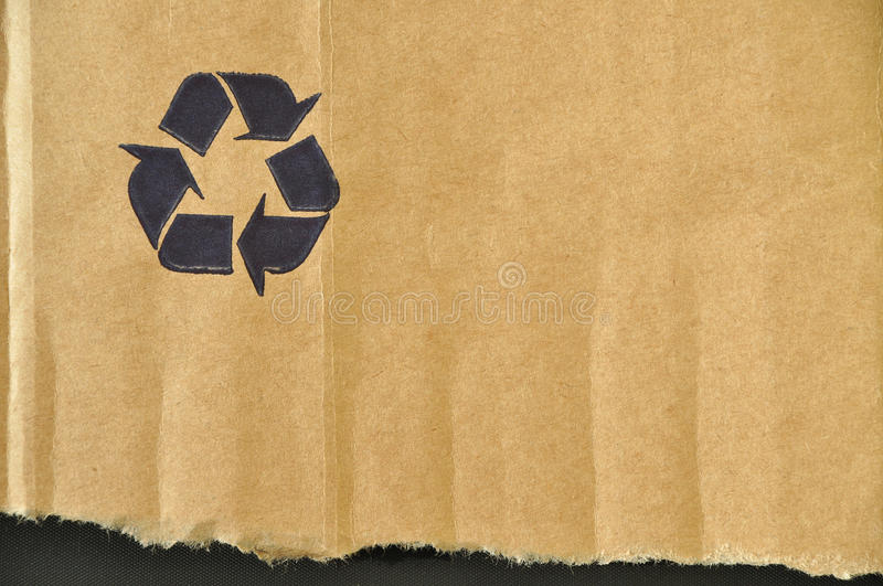 Torn cardboard. And paper recycling sign stock image
