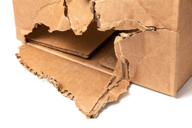 Torn cardboard box.  Loss and damage insurance concept stock image