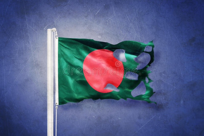 Torn flag of Bangladesh flying against grunge background royalty free stock photography