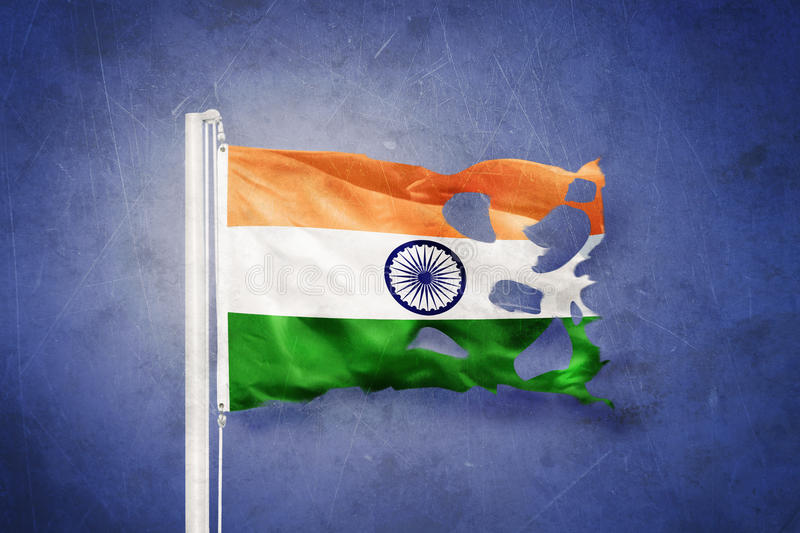 Torn flag of India flying against grunge background.  stock images