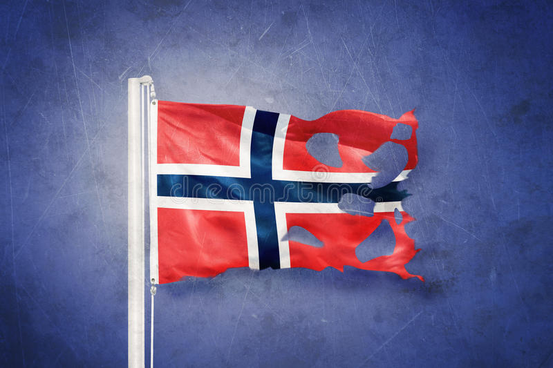 Torn flag of Norway flying against grunge background.  royalty free stock photography