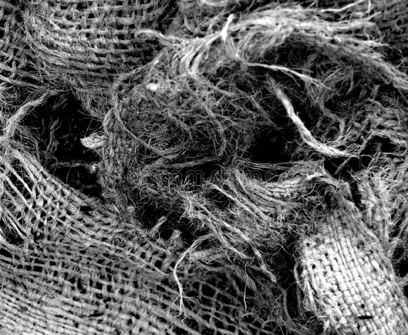 Torn and Frayed Burlap Bag in Black and White stock images