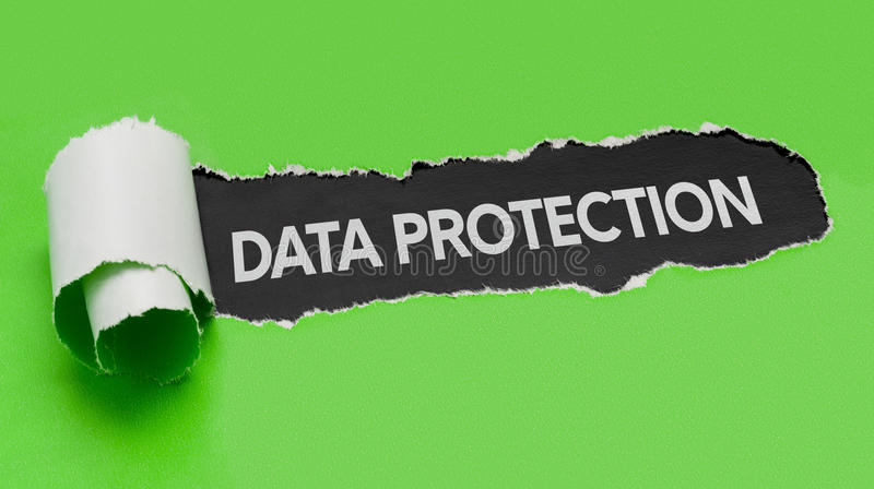 Torn paper revealing the word Data Protection stock photos