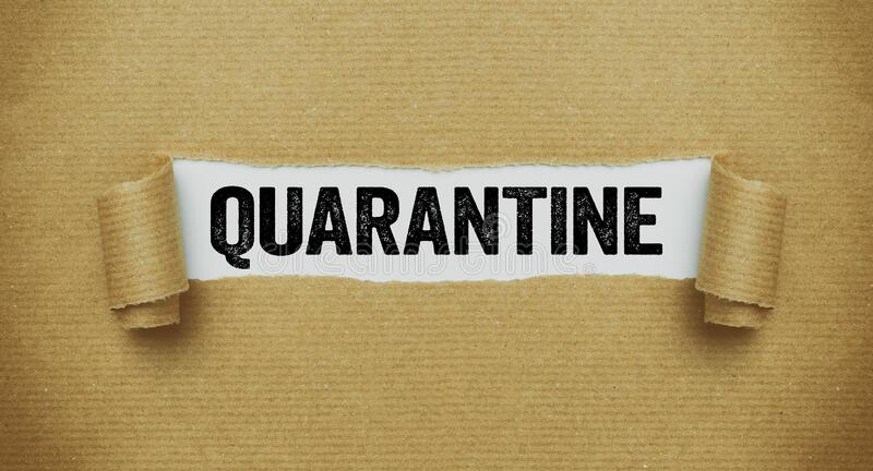 Torn paper revealing the word Quarantine stock image