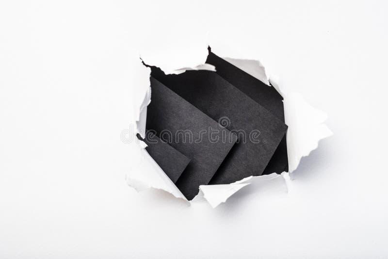 Torn paper ripped white sheet black base layer royalty free stock photo
