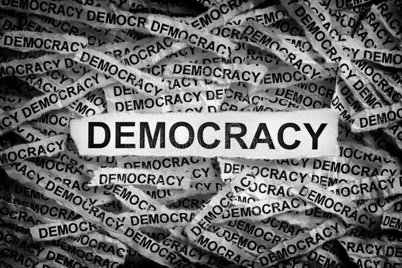 Torn pieces of paper with the word Democracy. Concept Image. Black and White stock images